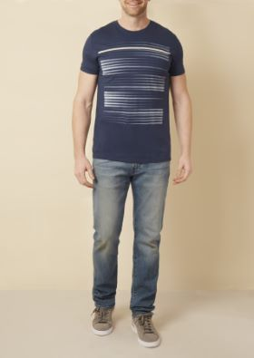 Man wearing blue graphic t-shirt with light blue jeans