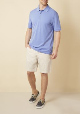 Man wearing blue polo shirt and khaki shorts
