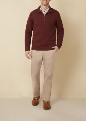 Man wearing maroon sweater with chinos