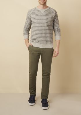 Man wearing striped gray long sleeve sweater and olive chinos